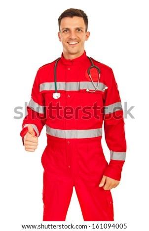Happy paramedic man giving thumb up isolated on white background - stock photo