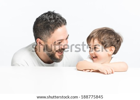 Happy parent and kid with real warm expression, smiling eachother - stock photo