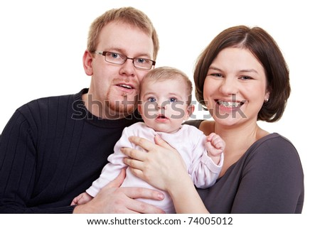 Happy parent smiling with baby girl in their arms - stock photo