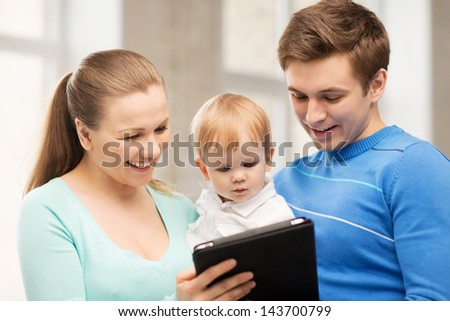 happy parents and adorable baby with tablet pc - stock photo