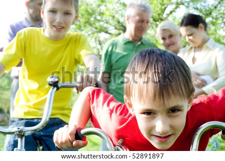 happy parents and children together outdoors - stock photo