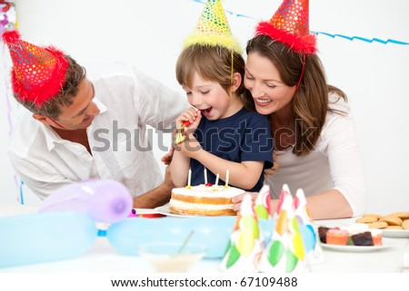 Happy parents celebrating their son's birthday at home