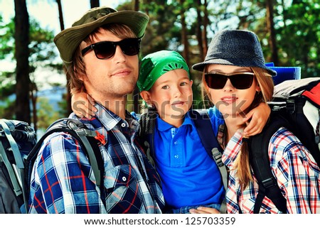 Happy parents hiking with their little son. - stock photo