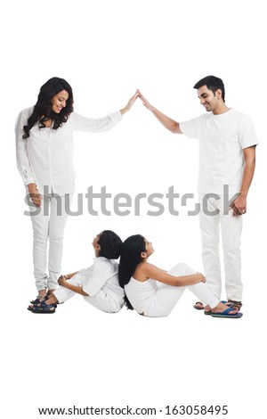 Happy parents playing with their children - stock photo