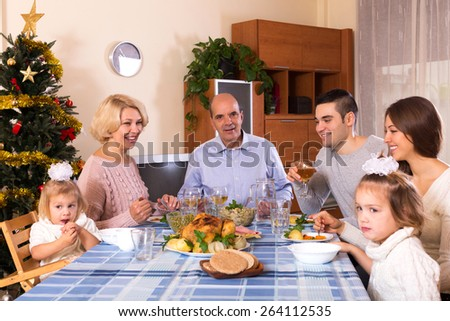 happy parents with adult kids and grandchildren celebrating xmas tonight - stock photo