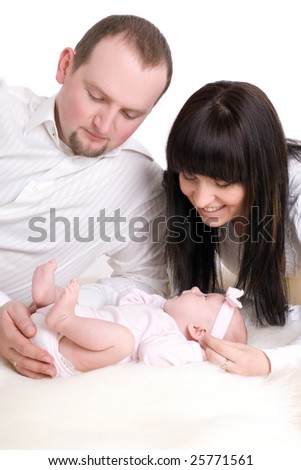 Happy parents with baby H - stock photo