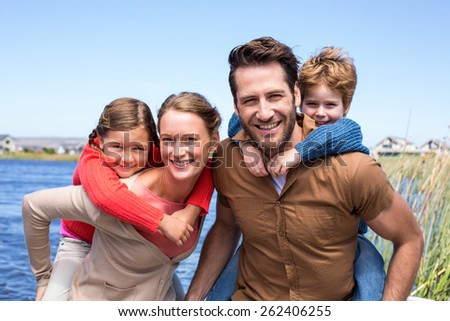 Happy parents with their children in the countryside - stock photo