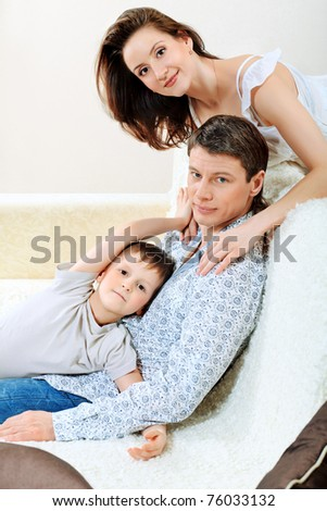 Happy parents with their son at home. - stock photo