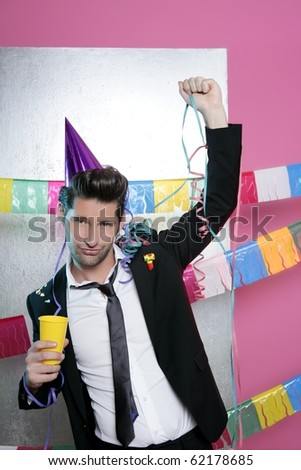 Happy party young man drinking enjoying alone dancing