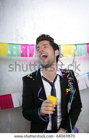 Happy party young man drinking enjoying alone dancing - stock photo