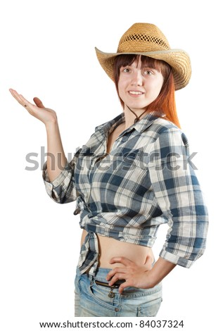 Happy pastoral  woman in  chequered shirt points hand over white