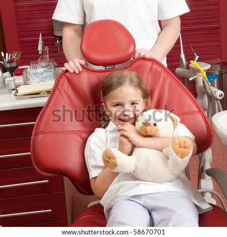 Happy patient at dental clinic (no-name teddy bear) - stock photo
