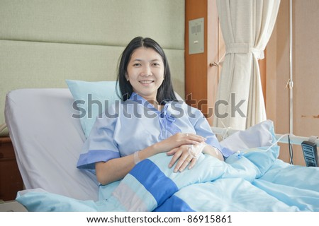 happy patient looking at camera on bed in hospital / clinic.healthcare insurance concept.