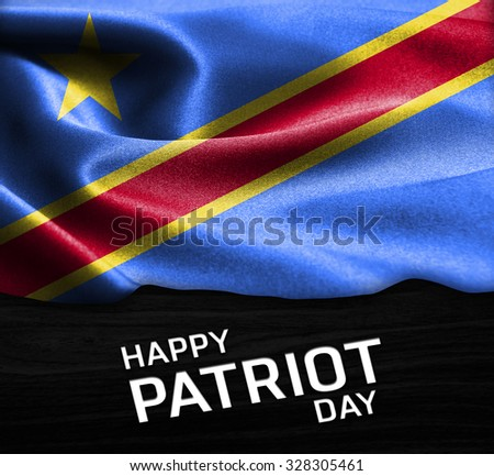 Happy Patriot Day Democratic Republic of the Congo flag on wood Texture background - stock photo