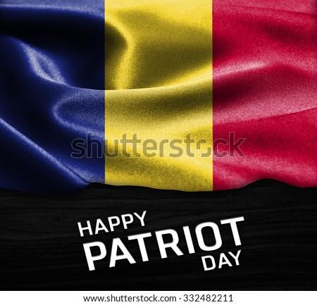 Happy Patriot Day Romania flag on wood Texture background - stock photo
