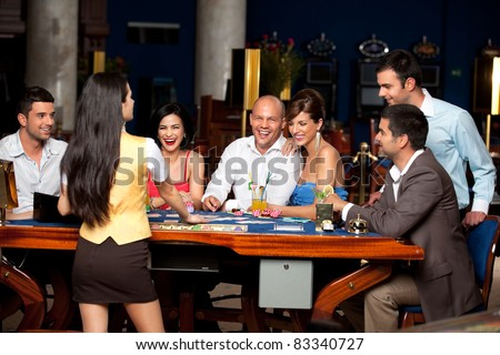 happy people and dealer playing blackjack - stock photo