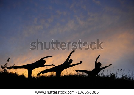Happy people at sunset along the clouds - stock photo
