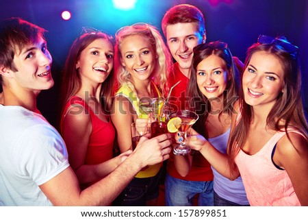 Happy people clinking by glases with each other - stock photo