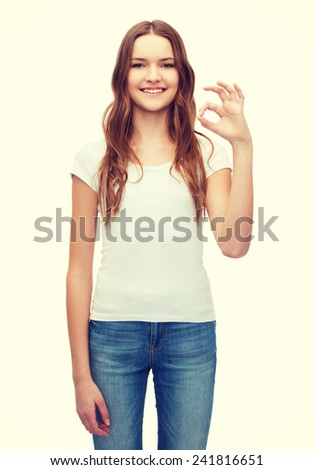 happy people concept - smiling woman in blank white t-shirt showing ok gesture - stock photo