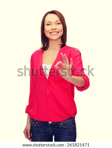 happy people concept - smiling woman in casual clothes showing ok gesture - stock photo