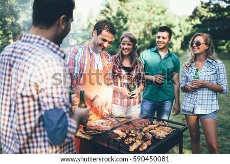 happy people having camping having bbq stock photo (royalty free