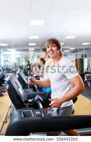 Happy people on treadmills - stock photo