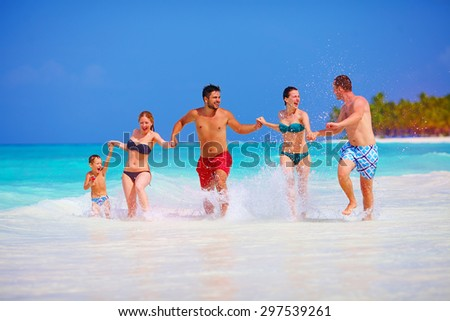happy people on vacation at tropical island