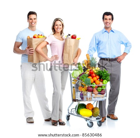 Happy people shopping with a  grocery cart. Isolated over white background. - stock photo