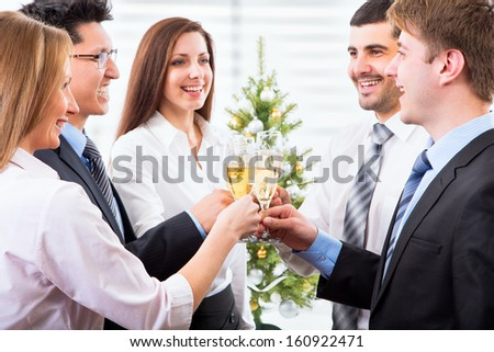 Happy people with of crystal glasses full of champagne - stock photo