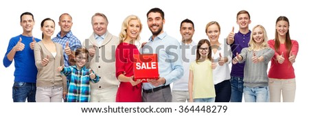 happy people with red sale sign showing thumbs up