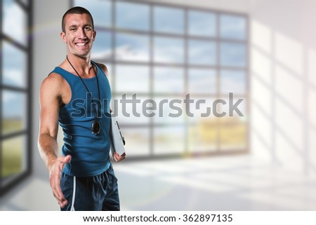 Happy personal trainer giving handshake against airplane flying past window - stock photo