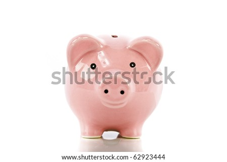 Happy piggy bank isolated on white - stock photo