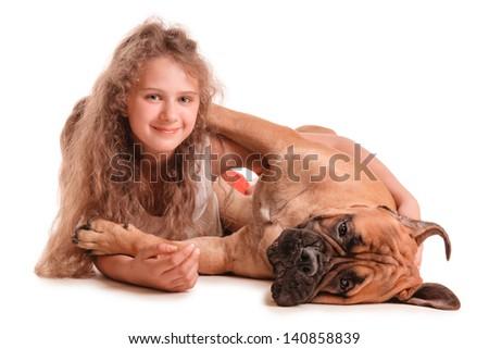 happy playful teenage girl and a dog bullmastiff. isolated on white background - stock photo