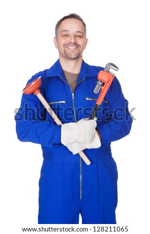 Happy Plumber Holding Plunger And Wrench On White Background - stock photo