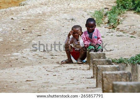 Happy poor african boys - smiling malagasy children - stock photo