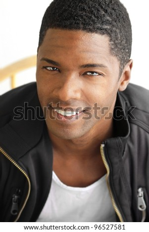 Happy portrait of a hip cool young black man with big smile - stock photo