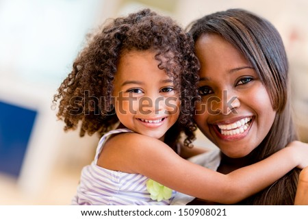 Happy portrait of a mother and daughter smiling  - stock photo
