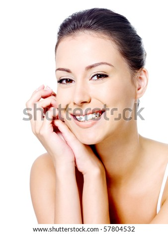 Happy portrait of beautiful smiling woman's face with clean fresh skin - isolated - stock photo