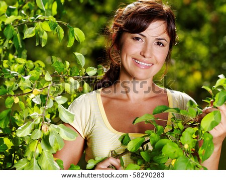 Happy portrait of beautiful woman on the nature - stock photo
