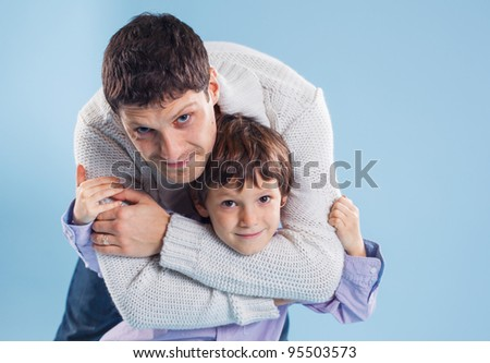 Happy portrait of the father and son of five years. In studio - stock photo