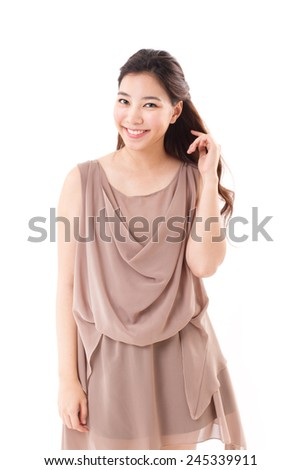 happy, positive asian woman in brown dress, white isolated background - stock photo