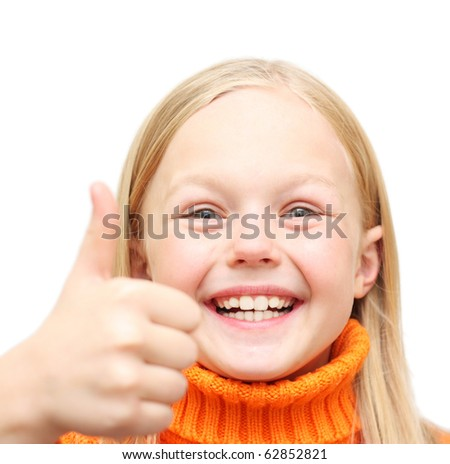 Happy positive blond girl in orange sweater show thumb up, isolated on white background. - stock photo