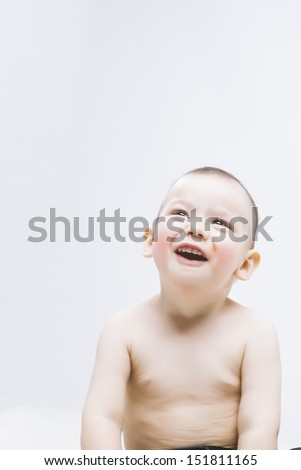 Happy Positive Little Cute child smiling and sitting over white background,vertical image