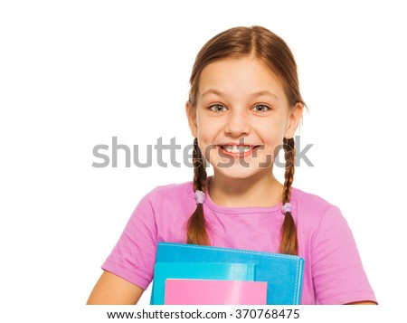 Happy positive pupil with books isolated on white - stock photo