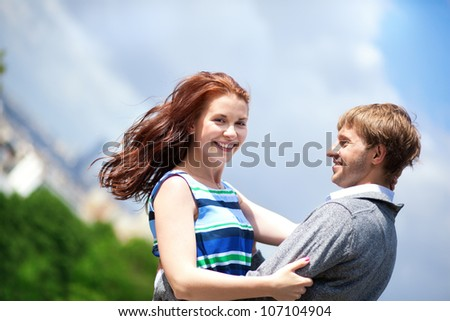 Happy positive romantic loving couple is hugging