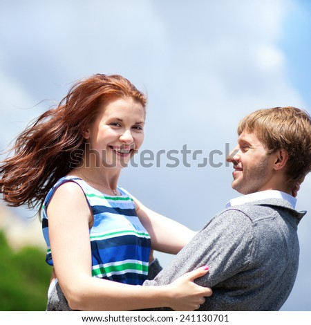 Happy positive romantic loving couple is hugging - stock photo