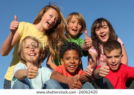 happy positive youth with thumbs up - stock photo
