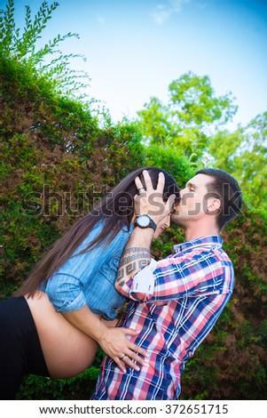 Happy pregnant couple outdoor - stock photo