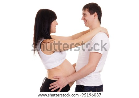 Happy pregnant girl with a guy on a white
