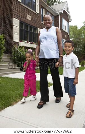 Happy pregnant mother with her kids - stock photo